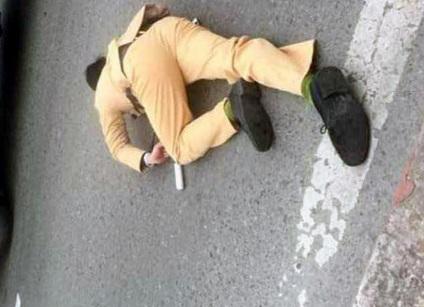 csgt 1582181346394 - Hà Nội: Đôi nam nữ vượt đèn đỏ, tông gục cảnh sát giao thông