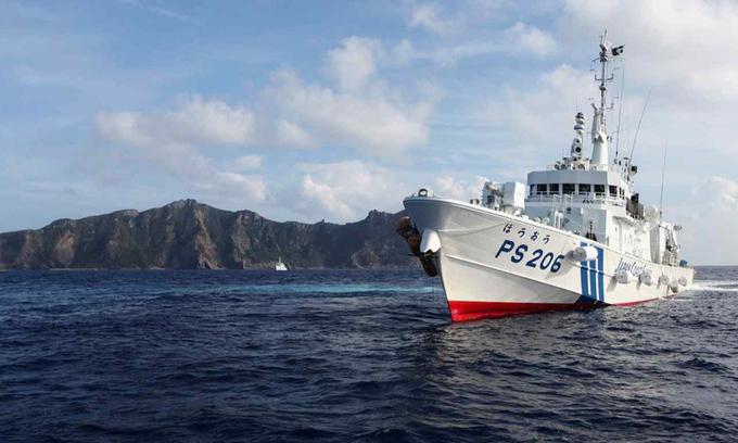 nhat ban reuters 7532 1617358977 - Nhật chuẩn bị kịch bản 20.000 người Trung Quốc đổ lên Senkaku/Điếu Ngư
